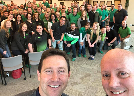 Picture of Jon Gordon with Idaho Central Credit Union Team members.