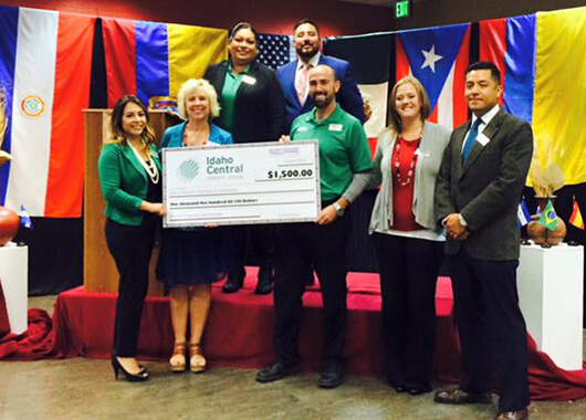 Idaho Central team members presenting a check to the Hispanic Chamber of Commerce.