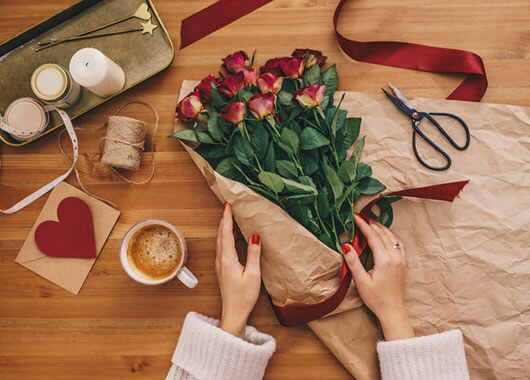 Women arranging red roses