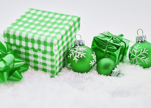 Green Presents and Christmas Ornaments on a White Bed of Snow