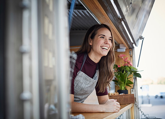 Small business owner smiling in food truck
