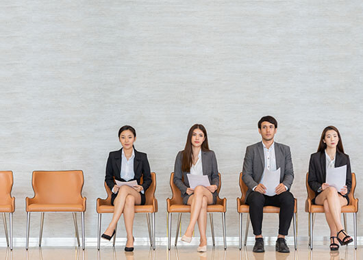 Four people sitting for a job interview