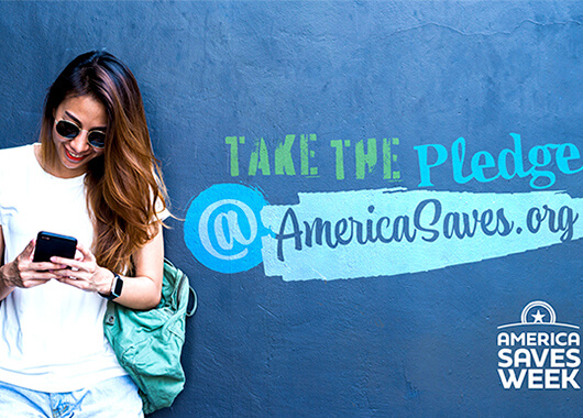 Woman taking the America Saves Week pledge